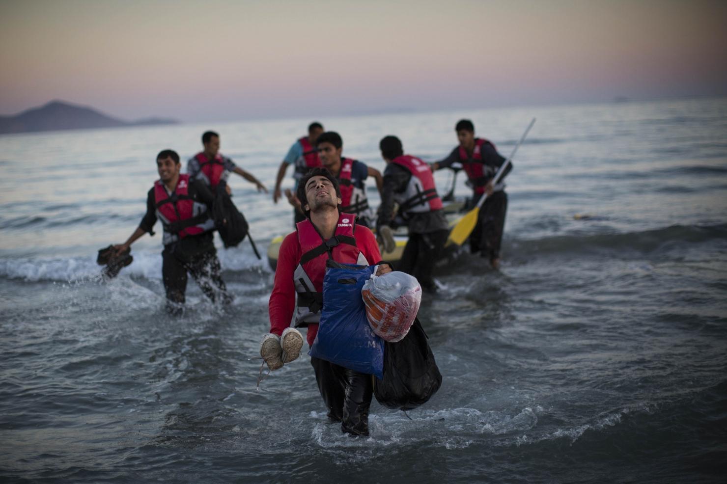 Un grup de migranți din Pakistan