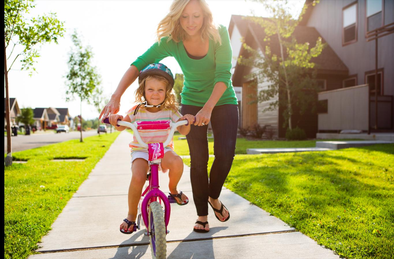 Copil pe bicicletă_România asigurată