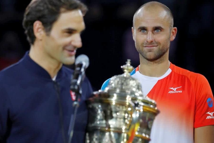 Copil și Federer