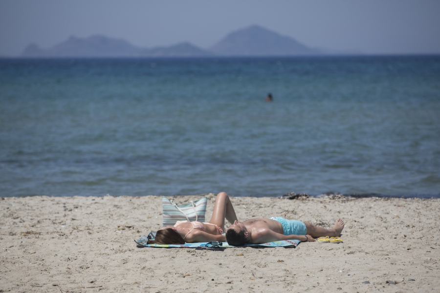 Turiști germani la plajă